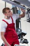 Mechanic repairing factory machine Stock Images