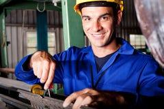 Mechanic repairing machine Stock Photo