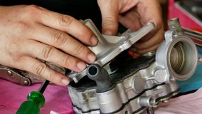 Mechanic repairing spare parts stock footage