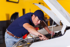 Mechanic repairing vehicle Royalty Free Stock Images