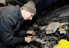 Mechanic repairman at car repair Royalty Free Stock Photos