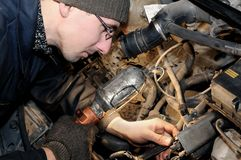 Mechanic repairman at car repair Royalty Free Stock Photo