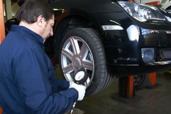 Mechanic repairs Stock Images