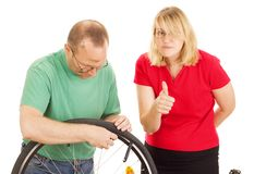 A mechanic repairs a bicycle Stock Photo