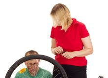 A mechanic repairs a bicycle Royalty Free Stock Image