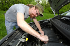 Mechanic repairs a car Royalty Free Stock Images