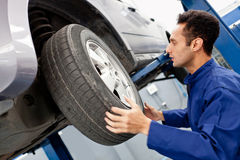 Mechanic reparing a car Stock Photos