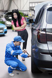 Mechanic replace a car wheel in the workshop Stock Photo