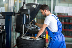 Mechanic replace tires on wheels Royalty Free Stock Photography