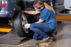 Mechanic Replacing Car Wheel At Repair Shop Royalty Free Stock Photos