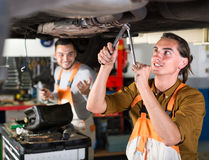 Mechanic replacing catalyst converter Royalty Free Stock Photography