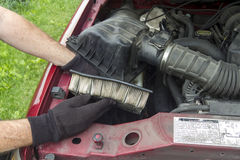 A Mechanic Replacing A Dirty Air Filter In A Truck Stock Images