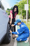 Mechanic replacing a tire on the road Stock Image