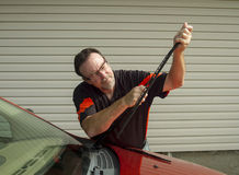Mechanic Replacing Wiper Blades On A Car Royalty Free Stock Photo
