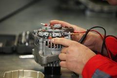 Mechanic restores a generator Stock Images