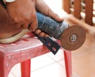 Mechanic sawing metal Stock Photography