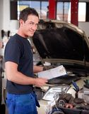 Mechanic with Service Report Royalty Free Stock Image