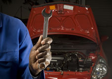Mechanic servicing car Royalty Free Stock Photo