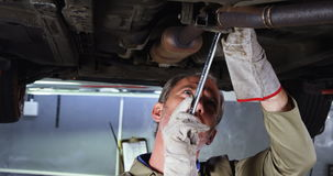 Mechanic servicing a car stock footage