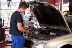 Mechanic Servicing Car Stock Photo