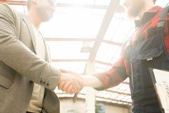 Mechanic Shaking Hands With Customer stock image
