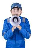 Mechanic is shouting with megaphone Stock Images