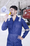 Mechanic shouting in the workshop Royalty Free Stock Images
