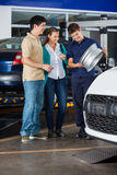 Mechanic Showing Alloy To Couple Stock Photo