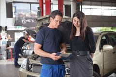 Mechanic showing the cost of service stock photos