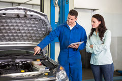 Mechanic showing customer the problem with car Stock Photo