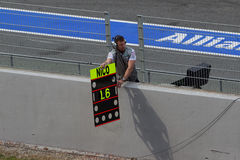 Mechanic showing laps to Nico Test Days Barcelona Stock Image