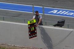 Mechanic showing laps to Nico Test Days Barcelona Stock Image
