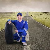 Mechanic showing thumb up on the road Stock Image