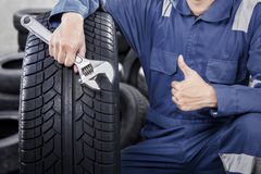 Mechanic shows ok gesture with thumb Stock Image