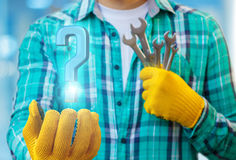 Mechanic shows a question mark. Stock Photo