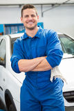 Mechanic smiling at the camera Stock Images