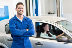 Mechanic smiling at the camera Royalty Free Stock Photography