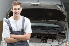 Mechanic smiling Stock Images