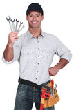 Mechanic with spanners Royalty Free Stock Image