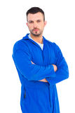 Mechanic standing arms crossed. Portrait of unsmiling male mechanic standing arms crossed on white background Stock Image