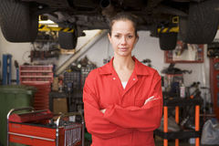 Mechanic standing in garage Royalty Free Stock Photo