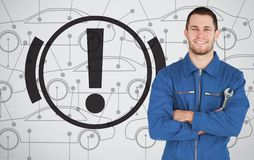 Mechanic standing next to parking break signal Royalty Free Stock Image