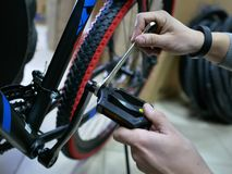 Mechanic standing and repairing the bicycle stock photos
