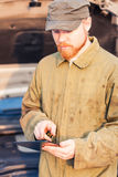 Mechanic with Tablet Royalty Free Stock Photography