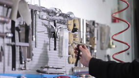 Mechanic takes two special tools for engine stock video footage