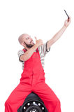 Mechanic taking a selfie and showing like gesture to camera. Isolated on white Royalty Free Stock Photos