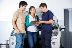Mechanic Taking Sign From Customers Stock Image