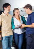 Mechanic Taking Sign On Document From Happy Couple Royalty Free Stock Photo