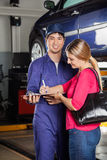 Mechanic Taking Sign On Invoice From Customer Royalty Free Stock Images