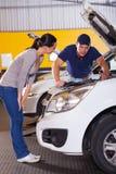 Mechanic talking customer Stock Photos
